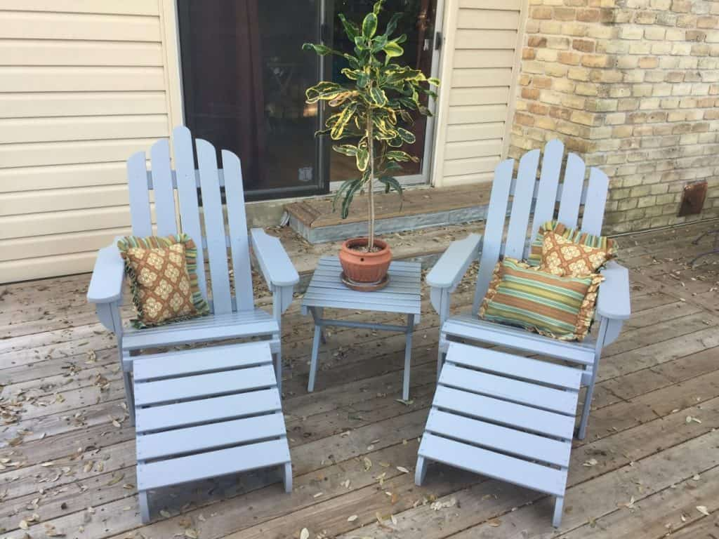 Renewed Adirondack furniture with plump pillows