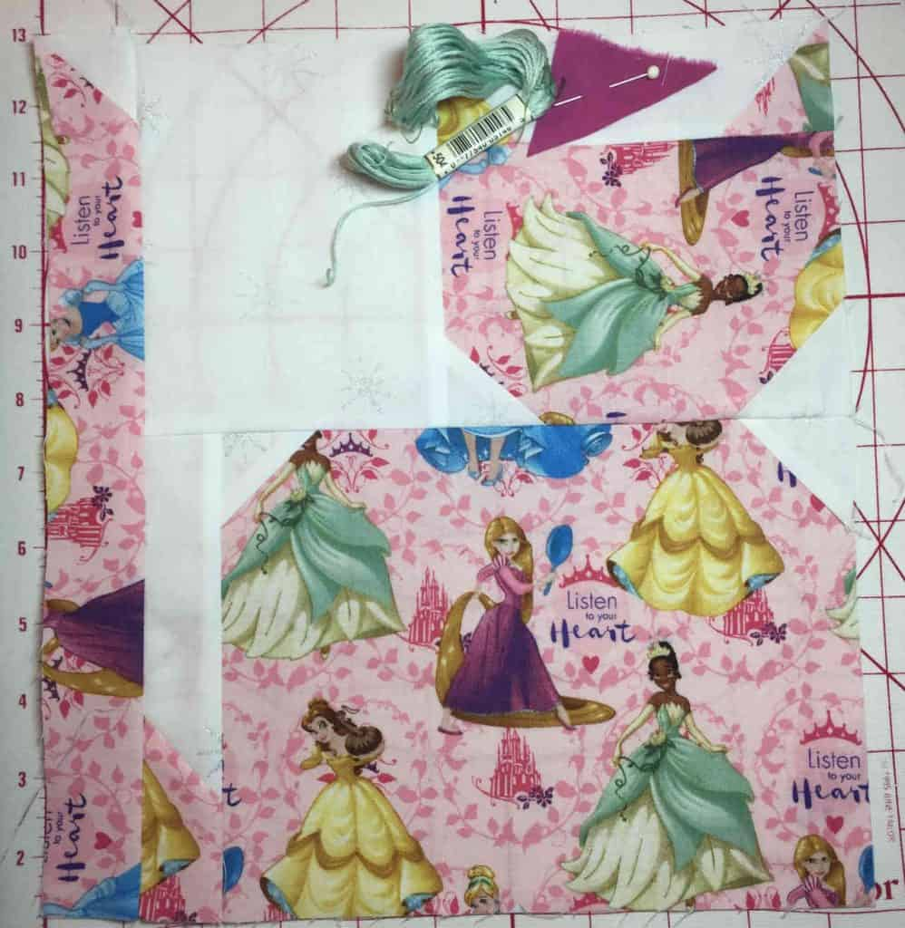 cat quilt block with coordinating thread and fabric swatch for the face