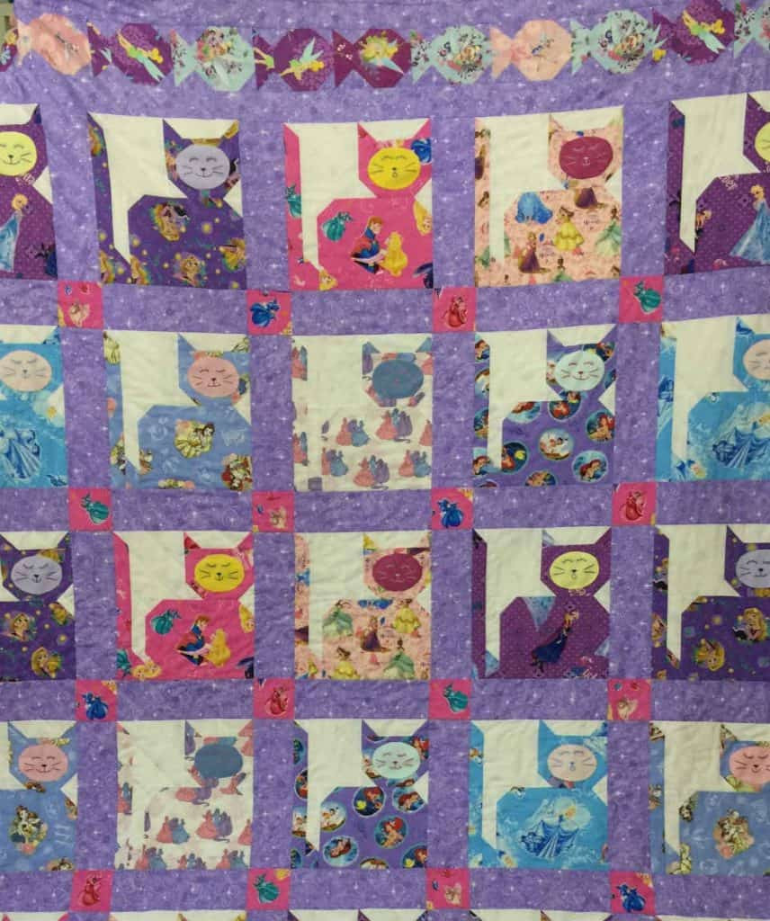 Quilt with cats, fish, princesses, fairies, and purple