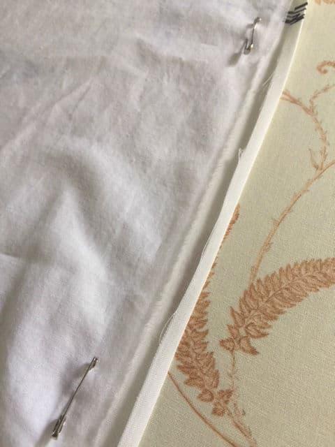 Fold and press the cut curtain edge
