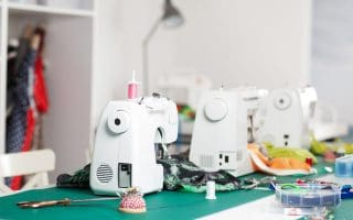 Multiple sewing machines in a work area