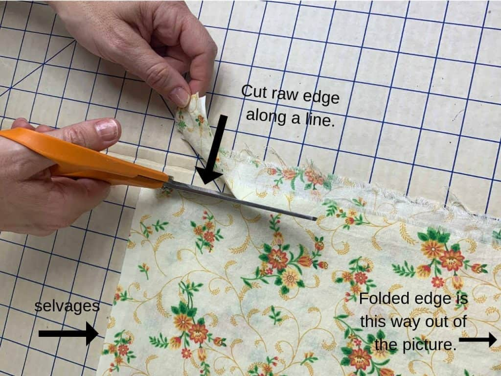 use scissors to square the fabric