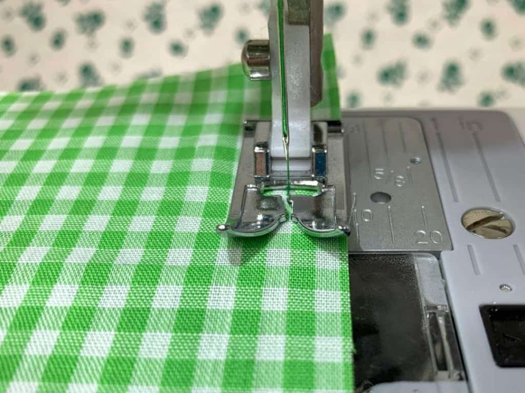 Use the edge of the presser foot as a guide to sew a straight seam