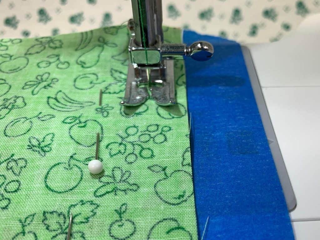 use painter's tape as a guide to sew a straight seam