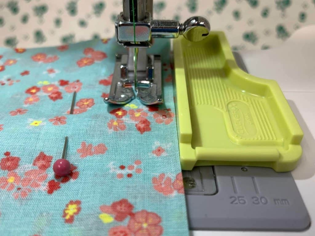 Use a removable seam guide to sew a straight line