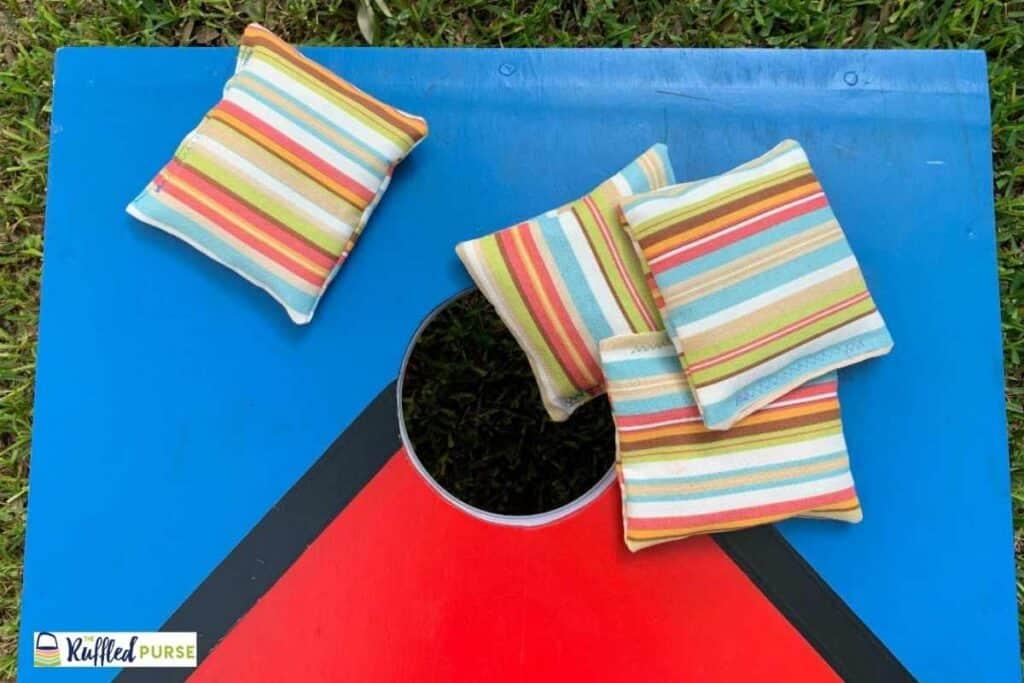 cornhole board with 4 bags