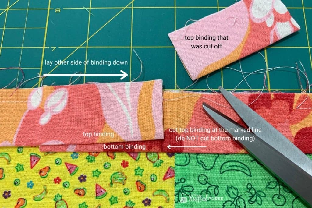 Lay binding down and cut