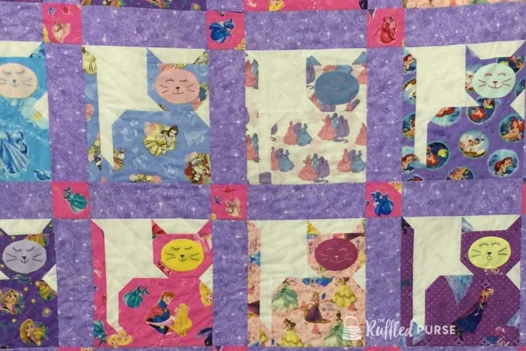 cat quilt blocks made with Disney princess fabric
