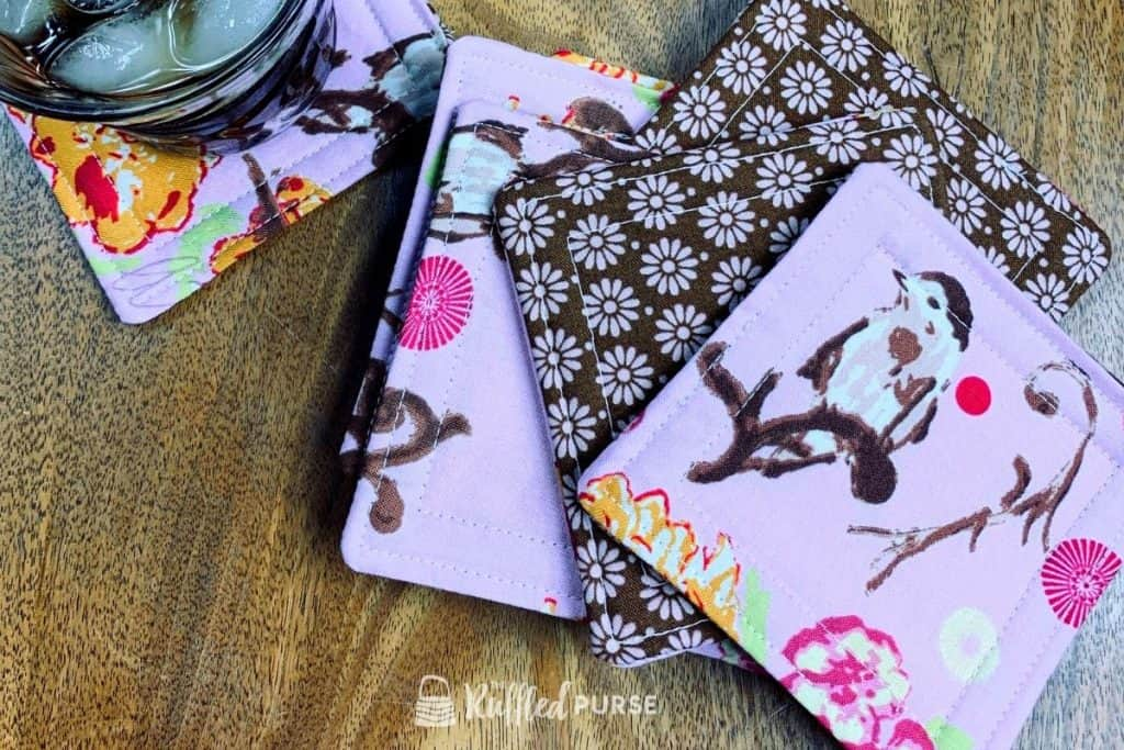 Fabric drink coasters made with bird and flower fabric.