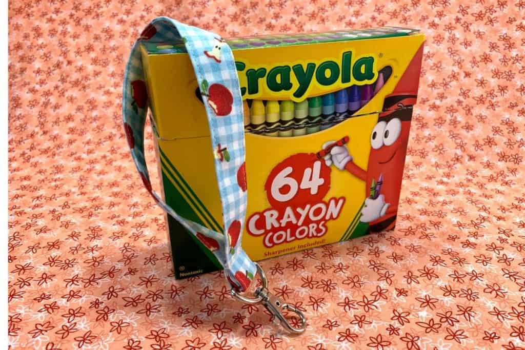A wristlet displayed on a Crayola box.