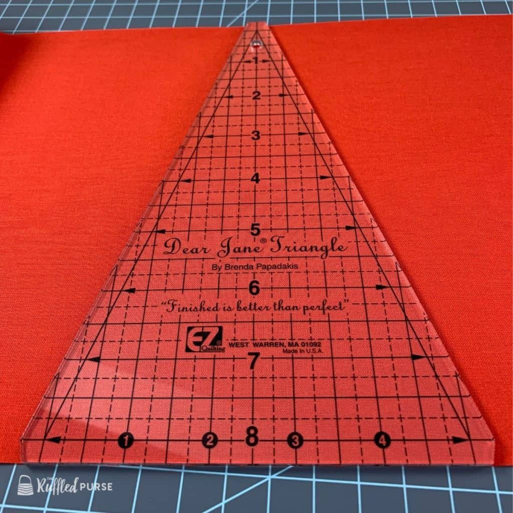 Width of fabric is the height of the triangle.