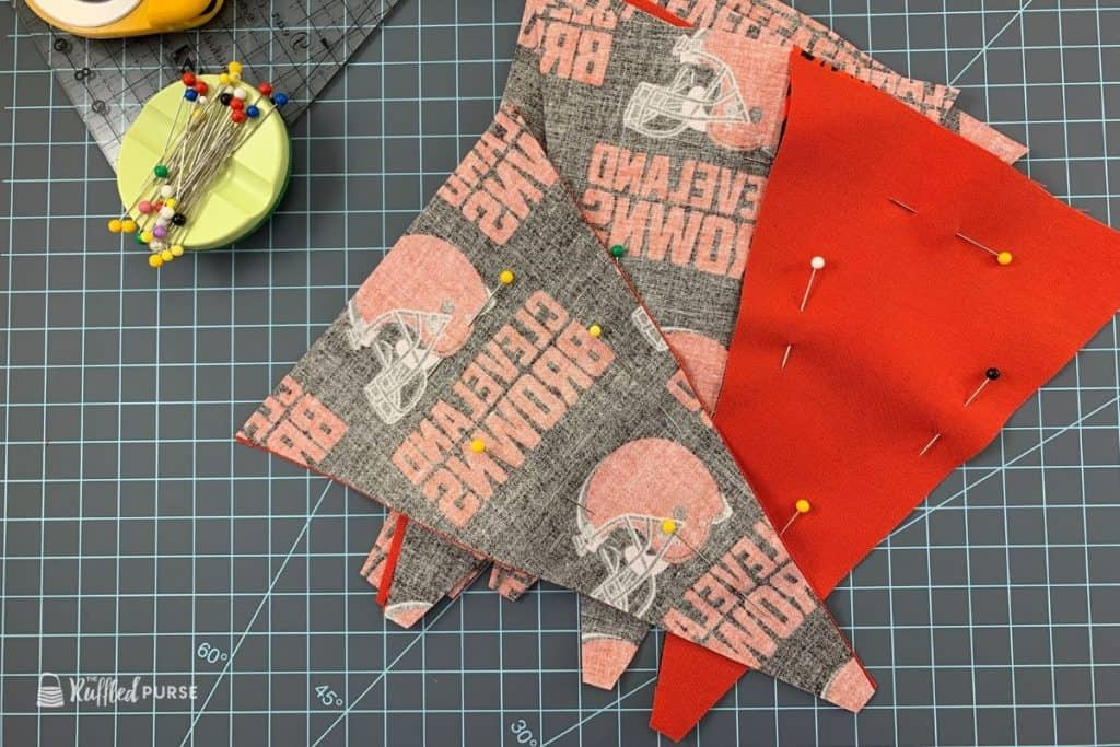 Pin two triangles with right sides of the fabric together