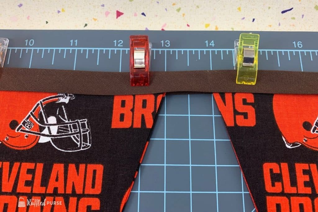 Space bunting flags evenly along the bias tape.