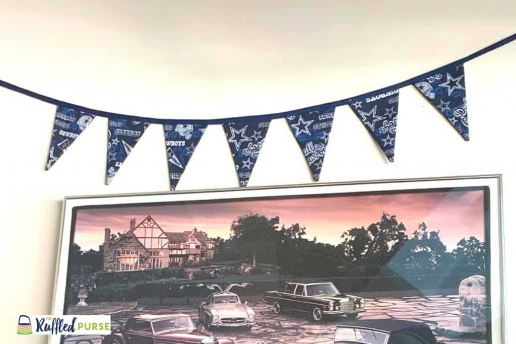 Dallas Cowboy bunting hanging on a wall in a man cave.