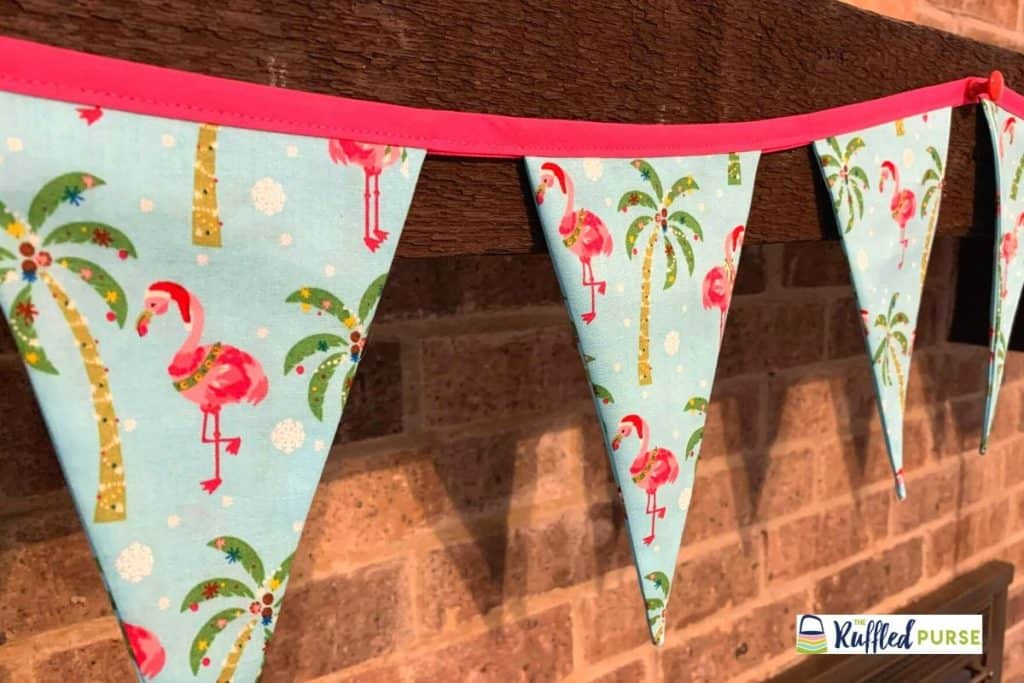 Christmas themed pennant banner is an easy to sew handmade gift.