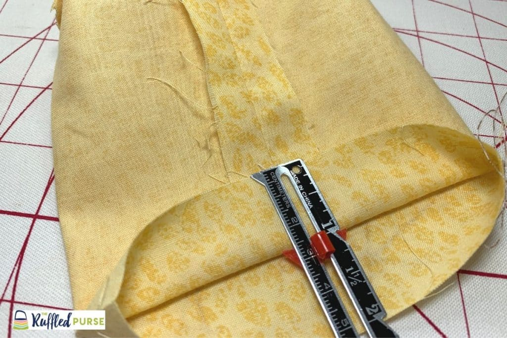 Turn the top edge of the lining out to the wrong side of the fabric.