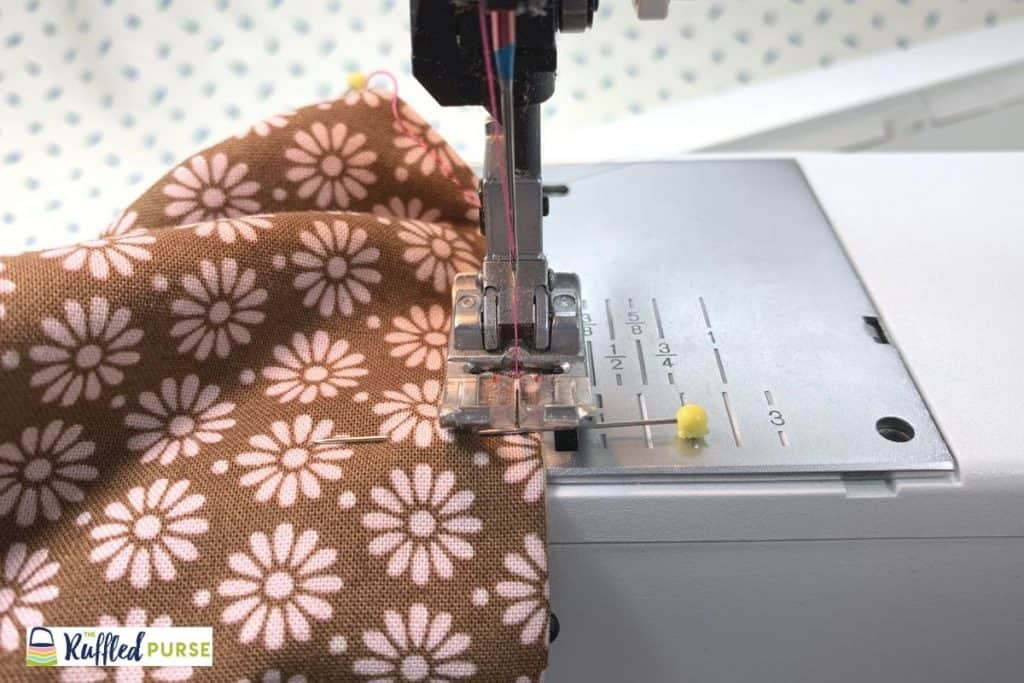 Sew the outer bag and lining together close to the top edge of the bag.