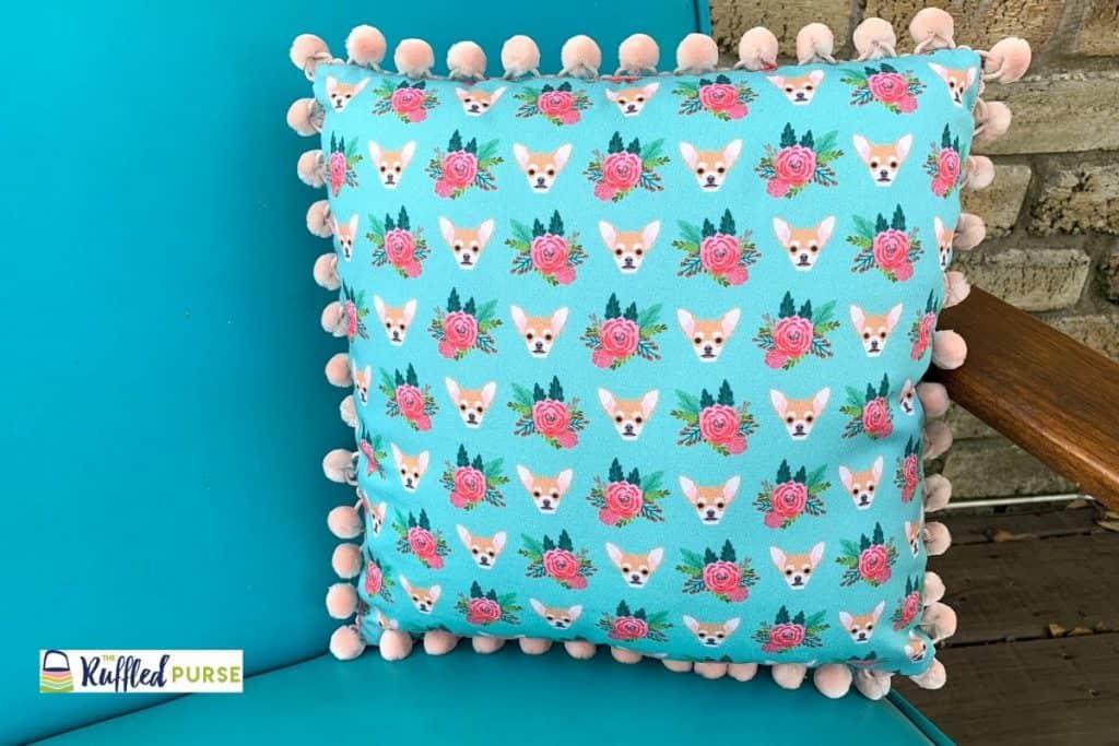 square pillow with pom-pom fringe