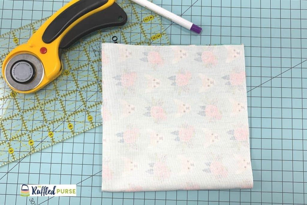 Fold fabric into fourths