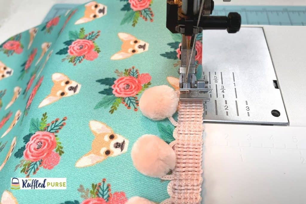 Use a zipper foot and start sewing at the bottom of the fabric.