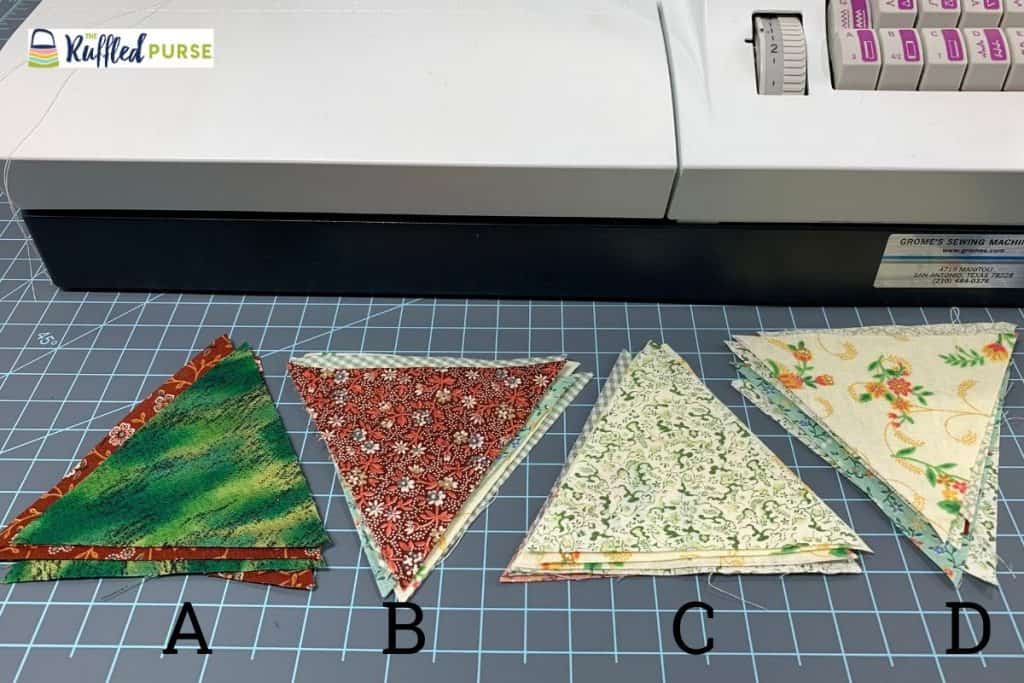 Put the triangles in piles so you know what to sew together.