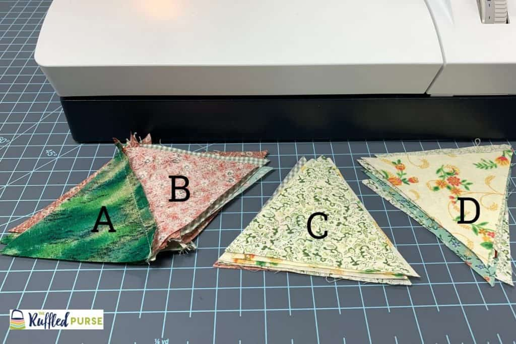 Lay the triangles in front of the sewing machine.