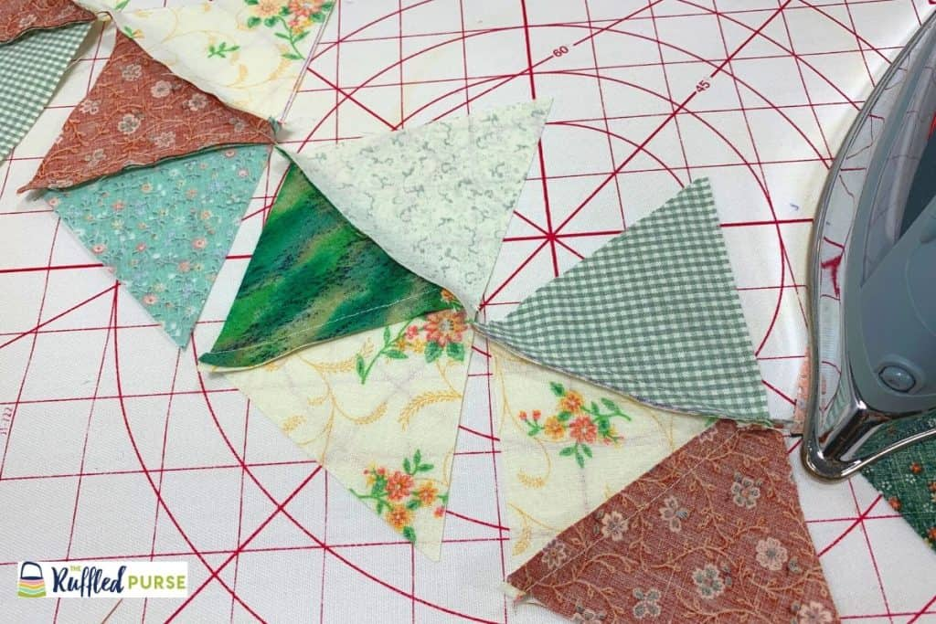 Press the seam with triangle C to one side.