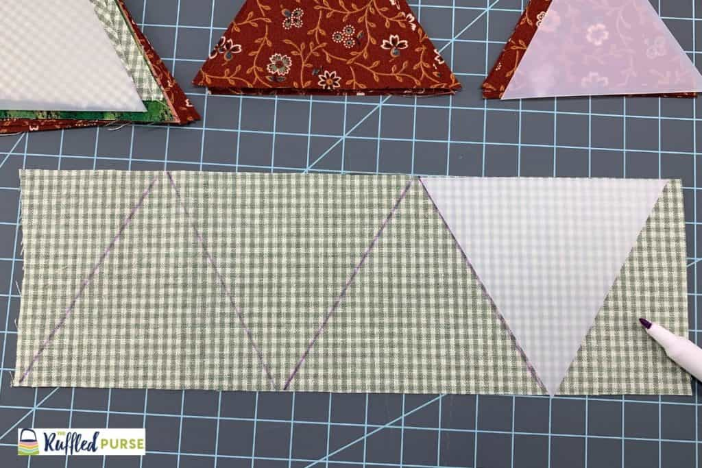 Trace template sides on a strip that is the triangle's height.