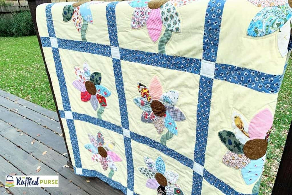 My apron quilt made with appliqued flowers.