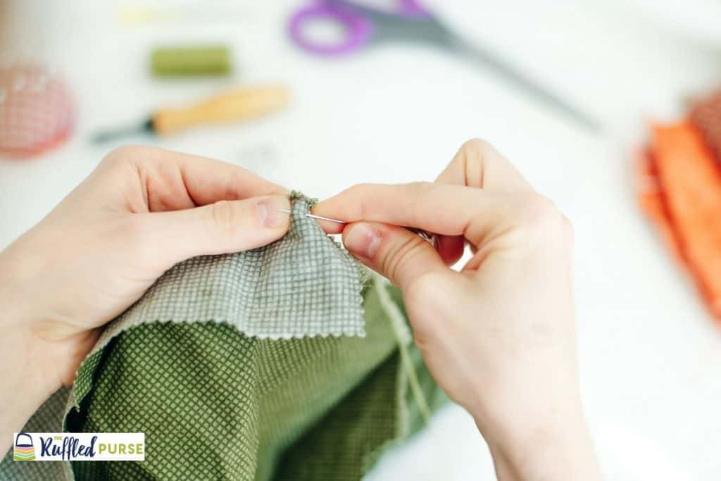 Close up of hand sewing