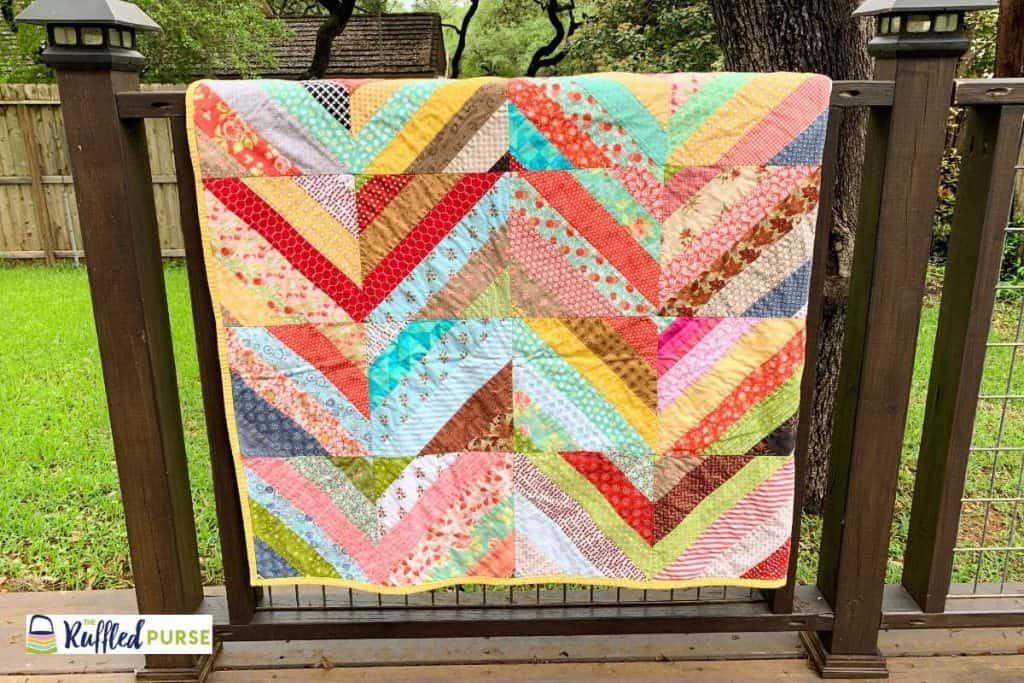 Strip pieced trunk quilt