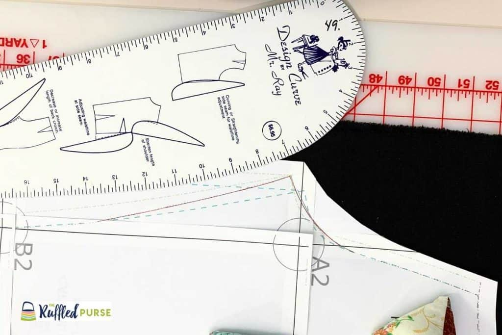 Grade the pattern between sizes with a ruler that has a curve.
