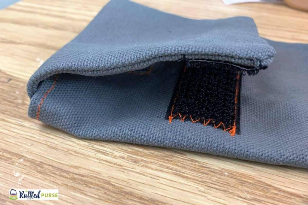 Short velcro pieces should line up after flap is attached.