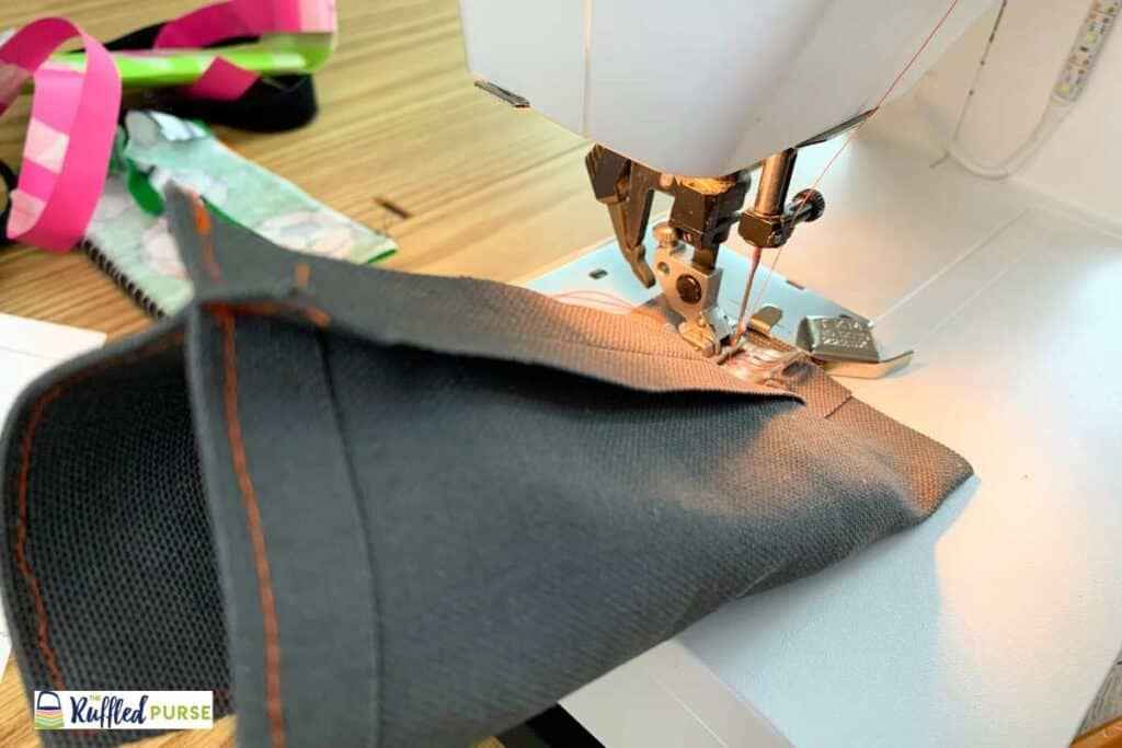Sew across the bottom of the outer fabric.