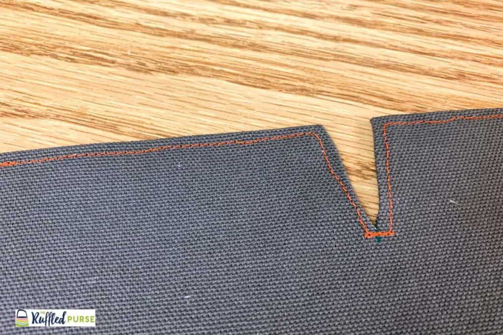 Top stitch along edges of top and the slit.
