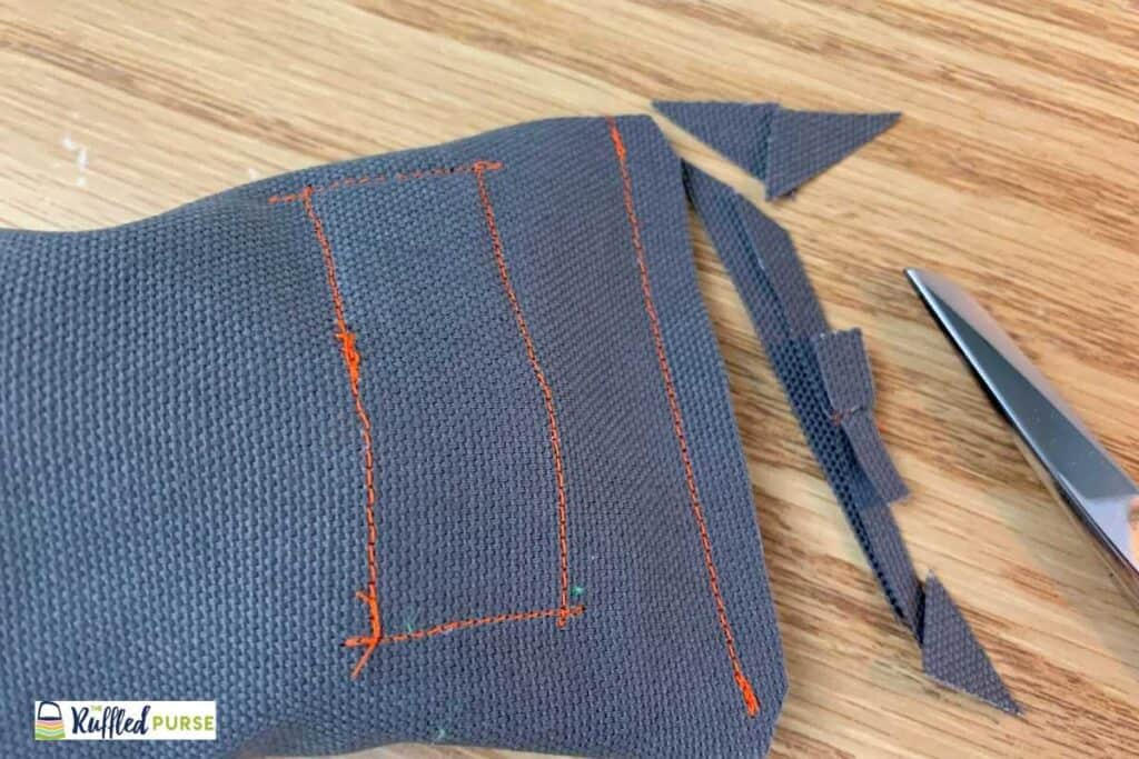 Clip corners and trim the bottom seam allowance.