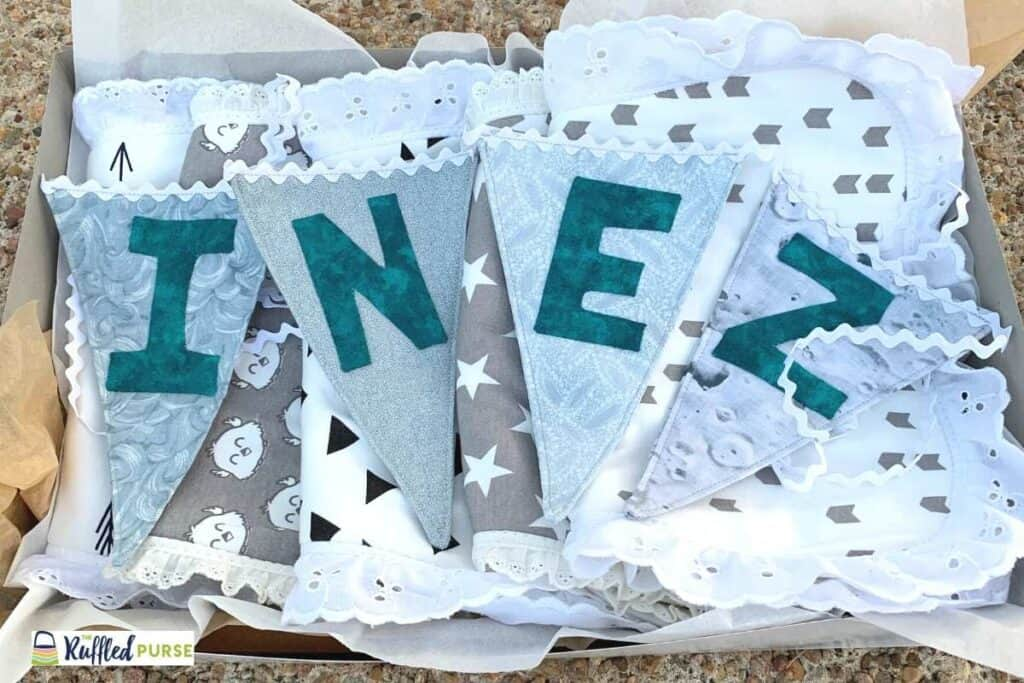 Baby shower gift. Bunting in a box with child's name.