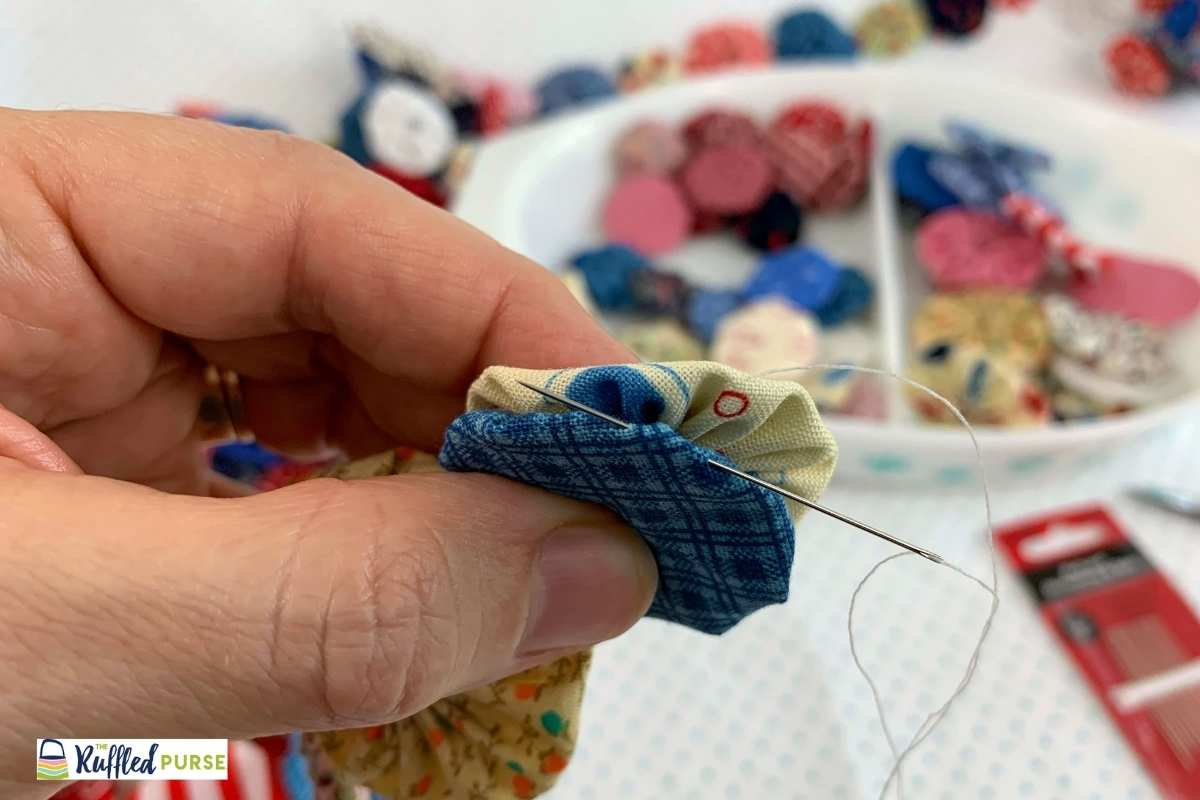 use ladder stitch to connect two yo-yos