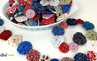 bowl of fabric yo-yos surrounded by garland
