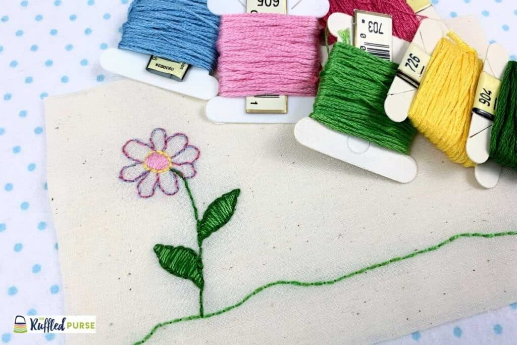 An embroidery flower done with the backstitch and satin stitch.