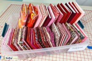 bin of red and pink fabric