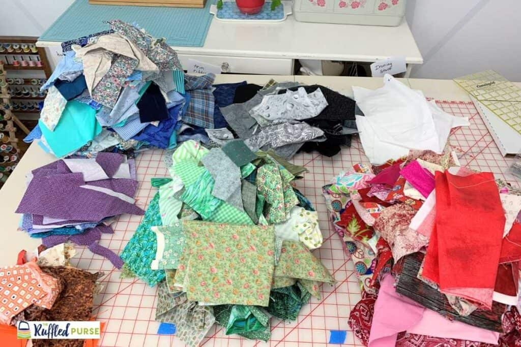 Small fabric pieces sorted by color