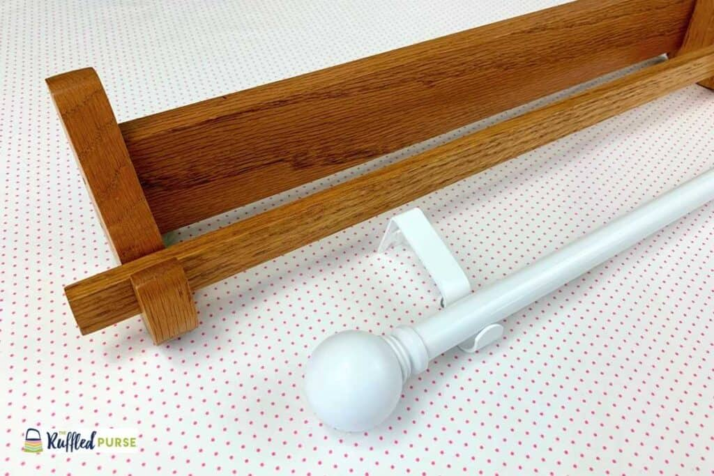 A wall mounted quilt rack and curtain rod with brackets