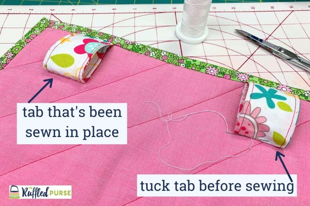 Sew the bottom of the hidden tabs