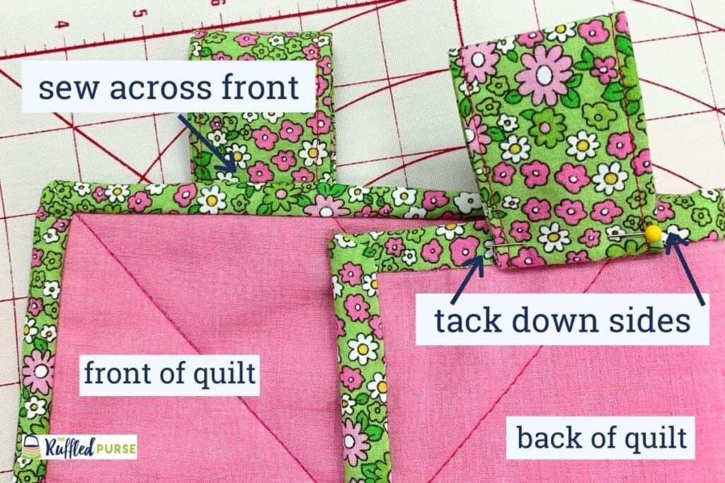 Flip up and sew the visible tabs in place