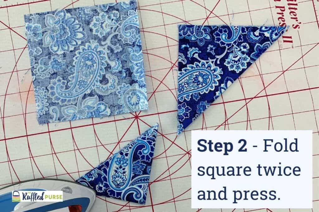 Fold and press squares to make triangles