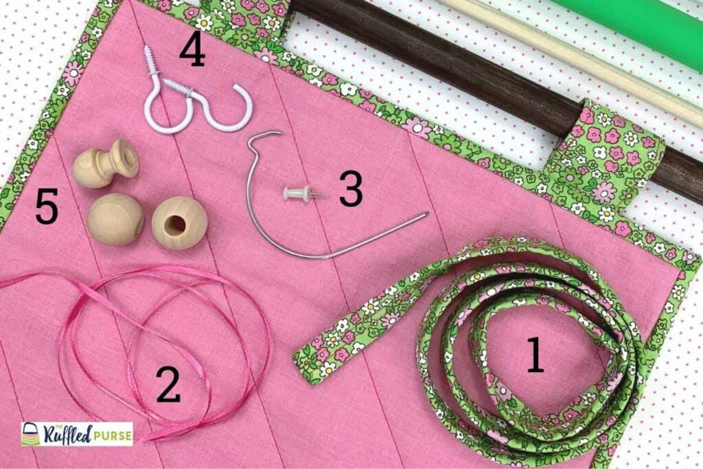 Supplies for hanging quilts with tabs