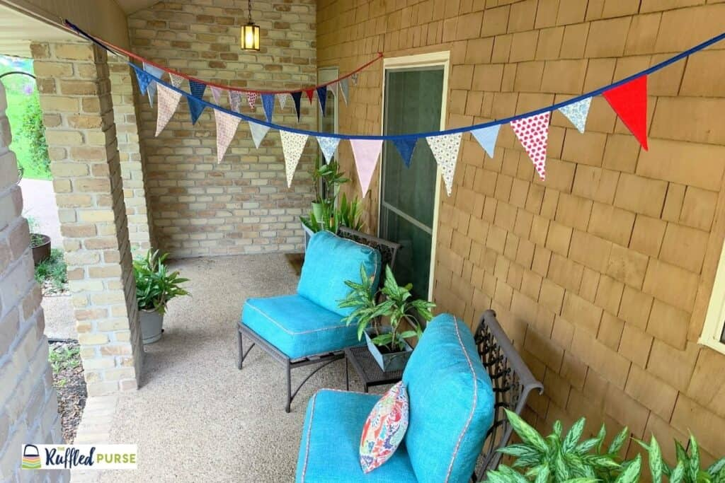 Patriotic bunting hanging on a porch.