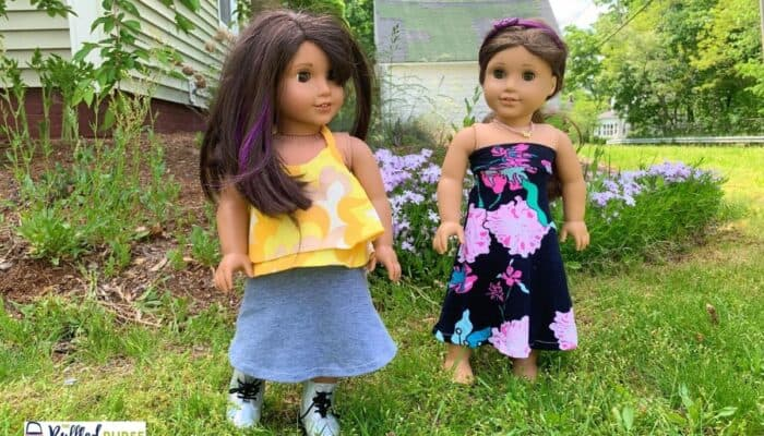 2 American Girl dolls in handmade clothes